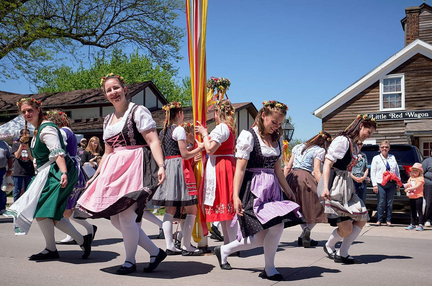 Women perform the ceremonial folk Maypole dance around a tall pole garlanded at Amana Colonies in Iowa
